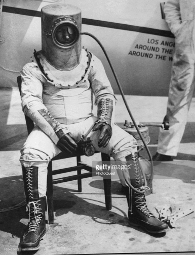 8/34 - Wiley Post, American aviator, is shown in a stratosphere suit of his own design. The suit was planned to maintain normal atmospherical pressure and oxygen content for his pioneering high-altitude research flights.